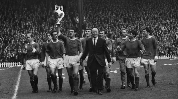 The title-winning Manchester United team parade the trophy at Old Trafford in 1967